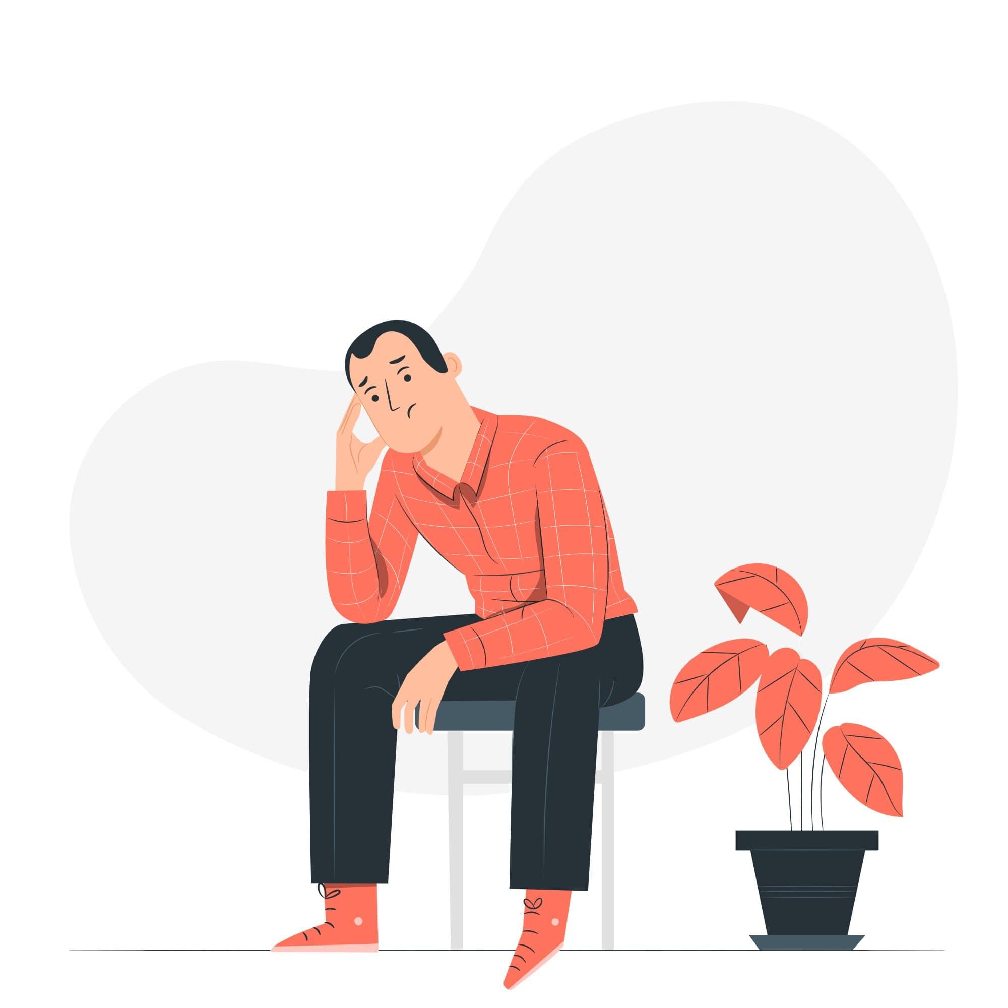 Hombre deprimido sentado deteniéndose la cabeza